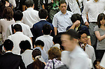 Tokyo, Japan - Japanese people rush to transfer trains. Morning commuters typically spend over one hour on the train going to work. Trains are usually so packed that train platform staff have to push commuters to fit in the train so that the doors can close shut. (Photo by Yumeto Yamazaki/AFLO)