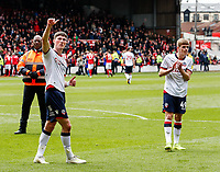 Bolton Wanderers' Jack Earing and Ronan Darcy applaud their side's travelling supporters at the end of the match  <br /> <br /> Photographer Andrew Kearns/CameraSport<br /> <br /> The EFL Sky Bet Championship - Nottingham Forest v Bolton Wanderers - Sunday 5th May 2019 - The City Ground - Nottingham<br /> <br /> World Copyright © 2019 CameraSport. All rights reserved. 43 Linden Ave. Countesthorpe. Leicester. England. LE8 5PG - Tel: +44 (0) 116 277 4147 - admin@camerasport.com - www.camerasport.com
