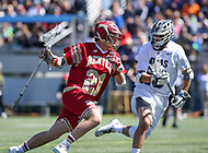 Washington, DC - March 31, 2018: Denver Pioneers Kyle Smith (21) is being defended by a Georgetown Hoyas defender during game between Denver and Georgetown at  Cooper Field in Washington, DC.   (Photo by Elliott Brown/Media Images International)