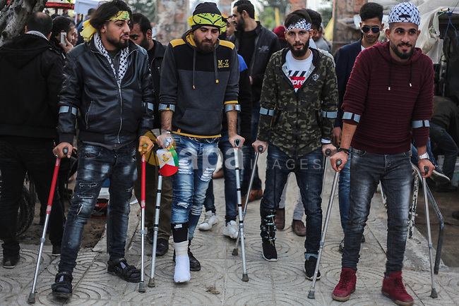 Palestinian supporters of the Fatah movement take part during a rally marking the fifty-four anniversary of the creation of the political party, in Gaza city on December 31, 2018. Photo by Ramez Habboub