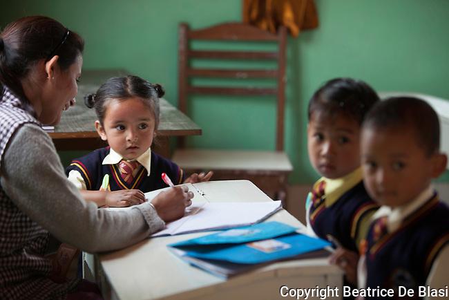 Teacher and pupils at Ambootia elementary school on the fair trade tea plantation, Darjeeling