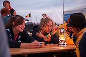 Scouts at the Jamboree in the evening on their first day at a cafe. Photo: Magnus Fröderberg/Scouterna
