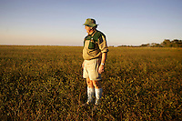 White farmer Thomas Beattie standing on once-productive farm land. Half of his land has been handed to Bright Matongo, a government minister with no farming experience, under the land redistibution program. Beattie once employed 1,400 workers, each with an average of seven dependents. Now he employs only 600, and the land taken by Mr Matongo supports only six full time workers. Despite the stated aim that land be distributed to 'the people', much productive land has been given to Zanu PF affiliates and subsequently wasted.