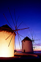 Greece. Mykonos Town. Illuminated windmills at dusk.