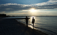 A sunset walk along the beach of Canatara Park is an ideal place to cool off during a hot summer night. Alexis Arthurs and Garth Saunders, both of Sarnia walk along the beach as summer starts to wind down.