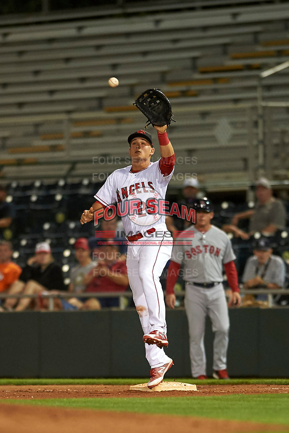 Scottsdale Scorpions first baseman Matt Thaiss (25), of the Los Angeles Angels organization, leaps to make a catch during an Arizona Fall League game against the Peoria Javelinas on October 20, 2017 at Scottsdale Stadium in Scottsdale, Arizona. the Javelinas defeated the Scorpions 2-0. (Zachary Lucy/Four Seam Images)