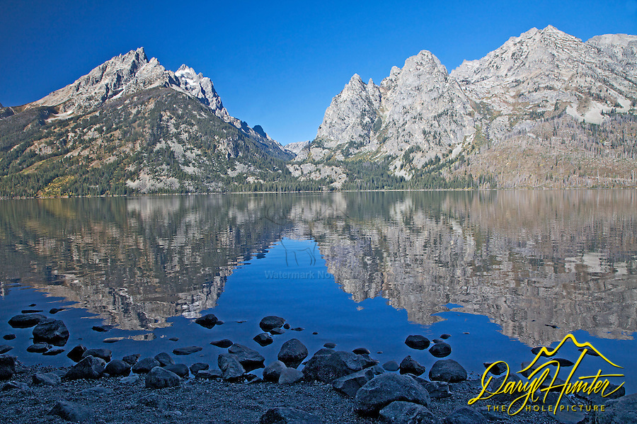 Jenny Lake Reflect the Grand Tetons. Jenny is one of the Glacial Moraine Lakes that line the foot of the Grand Tetons in Grand Teton National Park.<br />