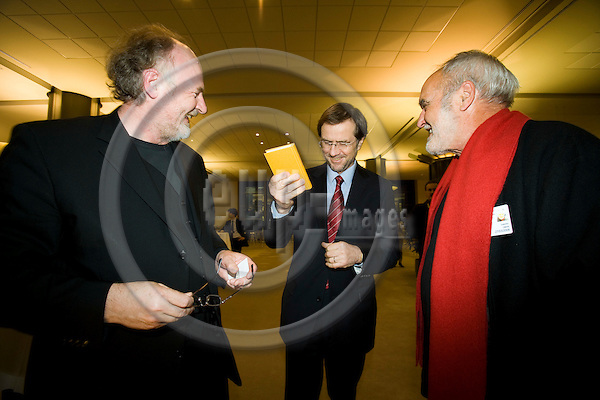 BRUSSELS - BELGIUM - 26 MARCH 2008 --  From left Lojze WIESER, writer of Europa Erlesen, MEP Alojz PETERLE, Slovenia, and Valentin OMAN, painter of the ECCE HOMO, with one of Wiesers books at the opening of their exhibition in the EU Parliament. Photo: Erik Luntang/EUP-IMAGES