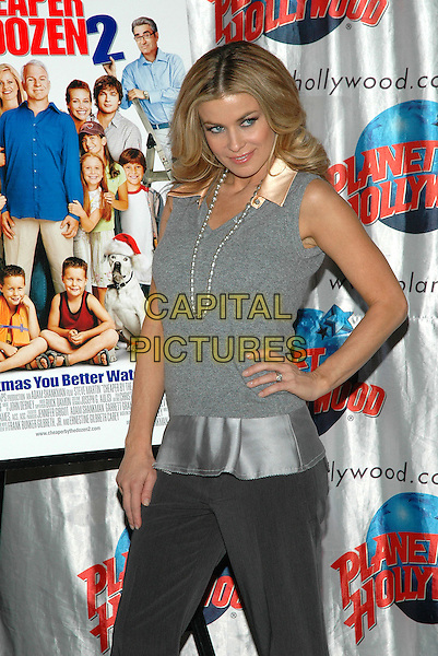 "CARMEN ELECTRA.Promotes her new film, ""Cheaper By The Dozen 2"" at Planet Hollywood in Times Square in New York City. .December 19th, 2005.Photo: Patti Ouderkirk/AdMedia/Capital Pictures.Ref: PO/ADM.half length grey gray vest pearl necklace hand on hip.www.capitalpictures.com.sales@capitalpictures.com.© Capital Pictures."