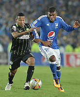 BOGOTA - COLOMBIA -31 -03-2016: Elkin Blanco (Der) jugador de Millonarios disputa el balón con Macnelly Torres (Izq) jugador de Nacional, durante partido aplazado de la fecha 9 entre Millonarios Atletico Nacional, de la Liga Aguila I-2016, jugado en el estadio Nemesio Camacho El Campin de la ciudad de Bogota.  / Elkin Blanco (R) jugador of Millonarios vies for the ball with Macnelly Torres (L) player of Nacional, during a postponed match between Millonarios and Atletico Nacional,  for the date 9 of the Liga Aguila I-2016 at the Nemesio Camacho El Campin Stadium in Bogota city. Photo: VizzorImage / Gabriel Aponte / Staff.