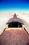 A rusty steam engine lies in the desert expanse known as the Train Cemetery in Uyuni, Bolivia.