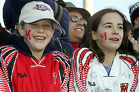 Unidentified Maryland fans smile over their team's victory. The University of Maryland defeated the University of New Mexico 1-0 in the NCAA Final at SAS Stadium in Cary, North Carolina, Sunday, December 11, 2005.