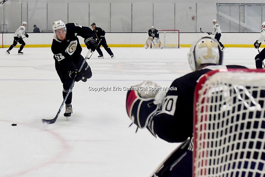 June 28, 2018: Boston Bruins defenseman Nick Albano (67) takes a shot at goalie Jeremy Swayman (70) skates during the Boston Bruins development camp held at Warrior Ice Arena in Brighton Mass. Eric Canha/CSM
