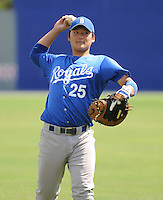 Catcher Jin-Ho Shin (25) of the Burlington Royals, Appalachian League affiliate of the Kansas City Royals, prior to a game against the Kingsport Mets on August 20, 2011, at Hunter Wright Stadium in Kingsport, Tennessee. Kingsport defeated Burlington, 17-14. (Tom Priddy/Four Seam Images)