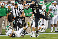 1 September 2011:  FIU's T.Y. Hilton (4) uses acrobatics to evade North Texas' Zach Olen (37) on the opening kickoff return as the FIU Golden Panthers defeated the University of North Texas, 41-16, at University Park Stadium in Miami, Florida.