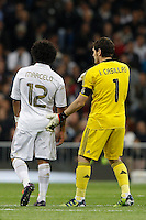 08.04.2012 SPAIN -  La Liga matchday 32th  match played between Real Madrid CF vs Valencia (0-0) and falls to 4 points behind Barcelona, at Santiago Bernabeu stadium. The picture show Iker Casillas (spanish goalkeeper of Real Madrid) and  Marcelo Vieira (Brazilian defender of Real Madrid)