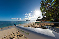 Morning scene at Waimanalo Beach, with outrigger canoes in the foreground and kayakers and Manana and Kaohikaipu Islands in the distance, Windward O'ahu.