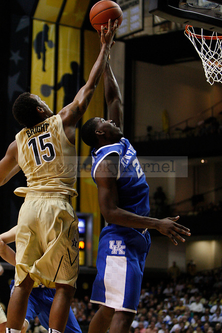UK forward Alex Poythress and Vanderbilt guard Kevin Bright jump to grab a rebound ball during the first half of the UK vs. Vanderbilt men's basketball game at Memorial Gymnasium in Nashville, Tn., on Thursday, January 10, 2013. UK won 60-58. Photo by Tessa Lighty | Staff