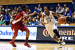 17 November 2013: Duke's Richa Jackson (15) and Alabama's Daisha Simmons (0). The Duke University Blue Devils played the University of Alabama Crimson Tide at Cameron Indoor Stadium in Durham, North Carolina in a 2013-14 NCAA Division I Women's Basketball game. Duke won the game 92-57.