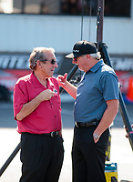 Sep 29, 2019; Madison, IL, USA; NHRA team owner Don Schumacher (left) talks with Alan Johnson during the Midwest Nationals at World Wide Technology Raceway. Mandatory Credit: Mark J. Rebilas-USA TODAY Sports