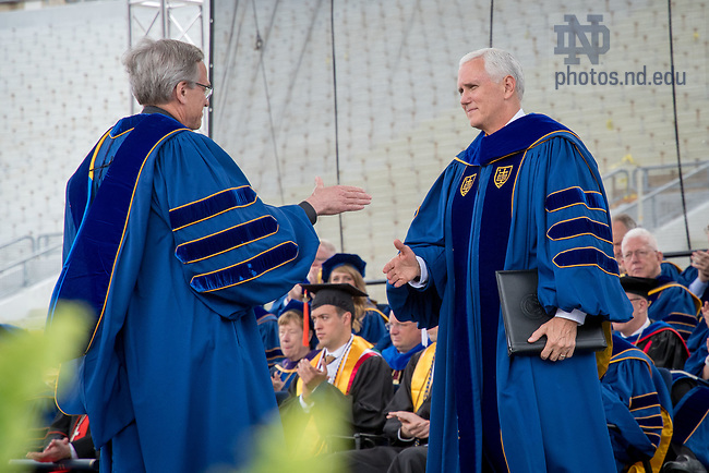 May 21, 2017; University of Notre Dame President Rev. John I. Jenkins, C.S.C. shakes hands with U.S. Vice President Mike Pence at Commencement 2017. (Photo by Matt Cashore/University of Notre Dame)