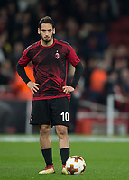 Hakan Çalhanoğlu of AC Milan warms up during the UEFA Europa League round of 16 2nd leg match between Arsenal and AC Milan at the Emirates Stadium, London, England on 15 March 2018. Photo by Vince  Mignott / PRiME Media Images.