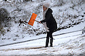 11/12/14<br /> <br /> A woman spreads grit from a road-side supply to clear the narrow lane that leads to her home near Flash after overnight snow fall settles on hills in the Staffordshire Peak District.<br /> <br /> ***ANY UK EDITORIAL PRINT USE WILL ATTRACT A MINIMUM FEE OF &pound;130. THIS IS STRICTLY A MINIMUM. USUAL SPACE-RATES WILL APPLY TO IMAGES THAT WOULD NORMALLY ATTRACT A HIGHER FEE . PRICE FOR WEB USE WILL BE NEGOTIATED SEPARATELY***<br /> <br /> <br /> All Rights Reserved - F Stop Press. www.fstoppress.com. Tel: +44 (0)1335 300098