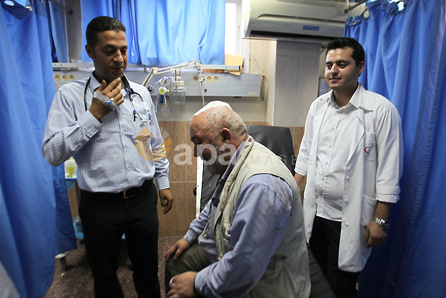 British Volunteer, David Amos, receives treatment at Rafidia hospital after Israeli settlers attack him as he was help Palestinian farmers in the West Bank village of Burin on Oct. 14, 2015. Israel began setting up checkpoints in Palestinian areas of annexed east Jerusalem as it struggled to stop a wave of attacks that have raised fears of a full-scale uprising. Photo by Nedal Eshtayah