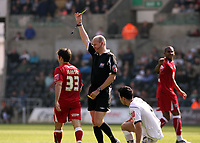 ATTENTION SPORTS PICTURE DESK<br /> Pictured: Referee Lee Mason (C) shows a yellow card to Lee Johnson of Bristol (L) for his foul against Leon Britton (3rd L)<br /> Re: Coca Cola Championship, Swansea City FC v Bristol City FC at the Liberty Stadium Swansea, south Wales. Saturday 18 April 2009.<br /> Picture by D Legakis Photography / Athena Picture Agency, Swansea 07815441513