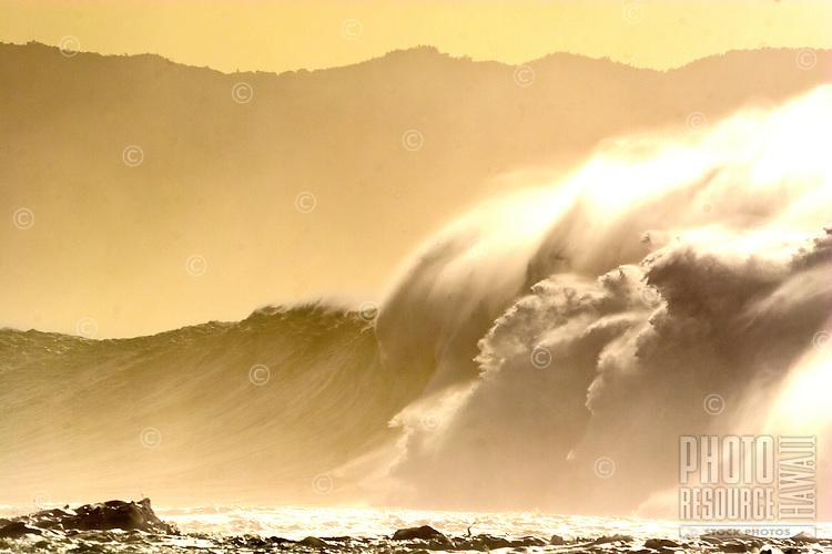 Huge winter surf at Waimea Bay, on the North Shore of Oahu