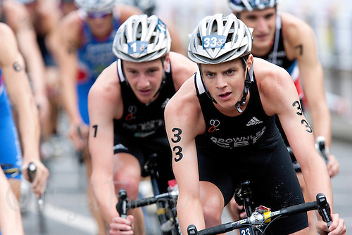 15 AUG 2009 - LONDON, GBR - Jonathan Brownlee leads brother Alistair Brownlee during the bike at the ITU World Championship Series Mens Triathlon (PHOTO (C) NIGEL FARROW)