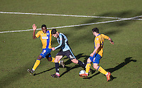 Joe Jacobson of Wycombe Wanderers takes on Chris Clements of Mansfield Town & Mitch Rose (left) of Mansfield Town during the Sky Bet League 2 match between Wycombe Wanderers and Mansfield Town at Adams Park, High Wycombe, England on 25 March 2016. Photo by Andy Rowland.