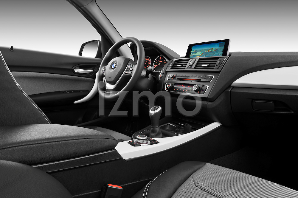 Passenger side dashboard view of a 2011 - 2014 BMW 118d 5 Door hatchback.