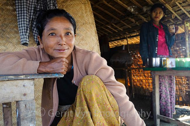 Rakhine woman and her daughter in Magyichaung village. Rakhine State, Myanmar.