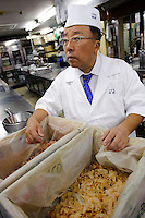 "Tamura Takashi, owner of ""Tsukiji Tamura"" Japanese restaurant, with a box of katsuobushi, Tokyo, Japan, July 17, 2009. Tsukiji Tamura is one of the best known ""ryotei"" traditional Japanese restaurants in Tokyo. Owner Tamura prepares dashi using two types of katsuobushi plus kombu from Hakodate in Hokkaido."