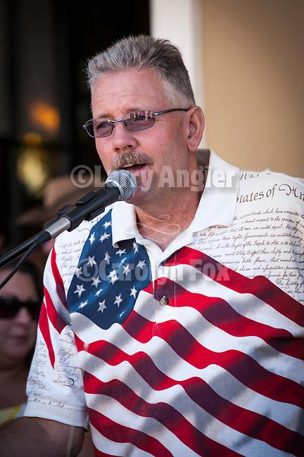 Independence Day celebration Main Street, Mokelumne Hill, California..Parade announcer, Dean Dix