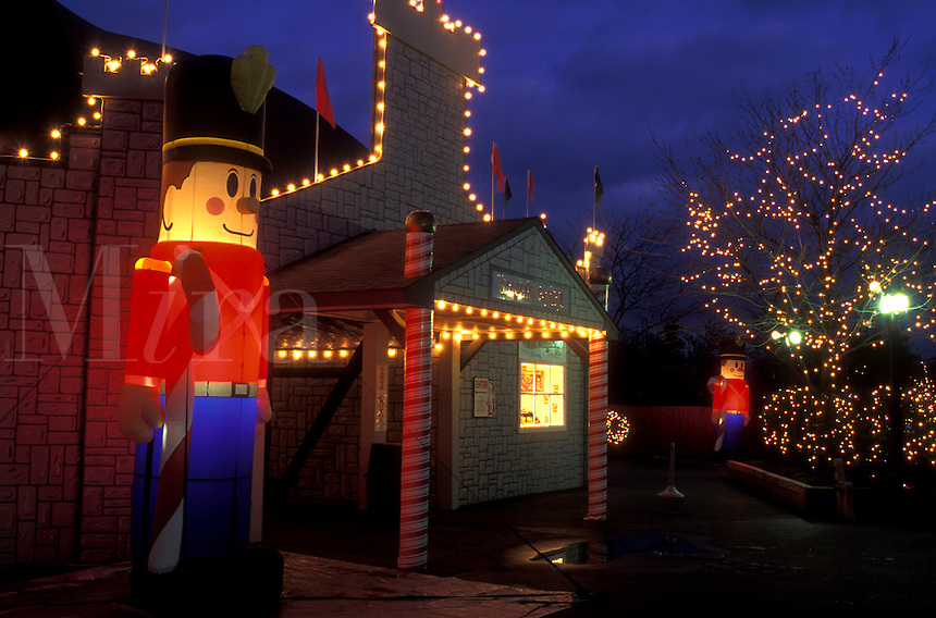 Pennsylvania, Hershey, Hershey Park, An illuminated toy soldier and Christmas lights decorate Hershey Park in the evening.