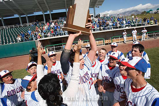 Panguitch's Brooks Leach holds trophy, celebrating his team's championship win. Panguitch High School claims the 1A State Baseball Championship with a 13-3 win over Piute Saturday, October 10 2009 at Utah Valley University in Orem.