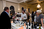 PROSPECT, CT-28 October 2014-102814EC03--   Fernando Ferreira of Iberia Wines out of East Hartford pours a sample during The Exchange Club of Wolcott's annual fundraiser. Tuesday night's wine tasting and silent auction benefited the Denis Y. Desaulniers charity and the club, which advocates against child abuse. Emily Welch is beside Ferreira. The event was at Aria in Prospect. Erin Covey Republican-American