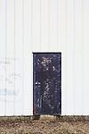 Black Door in White Building.