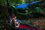 Jaguar (Panthera onca) biologist, Modesto Solis, resting in field camp in tropical rainforest, Kaminando Habitat Connectivity Initiative, Mamoni Valley, Panama