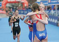 31 AUG 2007 - HAMBURG, GER - Kirsty McWilliam (GBR) congratulates team mate Hollie Avil on her victory - Junior Womens World Triathlon Championships. (PHOTO (C) NIGEL FARROW)