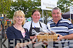 Noreen and Jessica Clinton offer cookies to Sean Gallagher at the Flavour of killorglin on Sunday