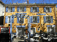 A restaurant in the Cote D'Azur region of southern France sports a colorful exterior.