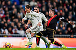 Luka Modric of Real Madrid (L) fights for the ball with Adrian Embarba Blazquez of Rayo Vallecano during the La Liga 2018-19 match between Real Madrid and Rayo Vallencano at Estadio Santiago Bernabeu on December 15 2018 in Madrid, Spain. Photo by Diego Souto / Power Sport Images