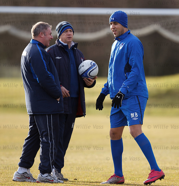 Ally McCoist laughing and joking with Madjid Bougherra. Arsenal, I'll give you arsenal....