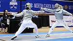DURHAM, NC - FEBRUARY 25: Notre Dame's Francesca Russo (left) attacks Duke's Lindsay Sapienza (right) during the Women's Saber championship match. The Atlantic Coast Conference Fencing Championships were held on February, 25, 2017, at Cameron Indoor Stadium in Durham, NC.