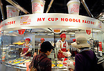 Visitors order toppings for their own original cup noodle at the My Cup Noodle Factory inside cup noodle maker Nissin's ramen (noodle) museum in Osaka, Japan on 20 October 2008. Ingredients on offer include cheddar cheese, garlic chips and dried shrimp..