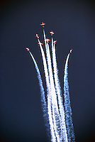 Canadian Forces Snowbirds flying in Close Formation performing Aerobatic Maneuver in Sky with Smoke - at Abbotsford International Airshow, BC, British Columbia, Canada