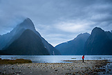 NEW ZEALAND, Fiordland National Park, Lone Woman walking around Milford Sound, Ben M Thomas
